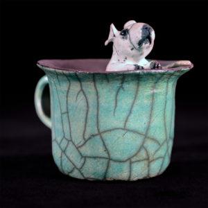 Souris dans une tasse